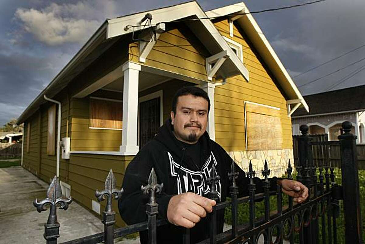 Investor Luis Jiminez stands outside a home that he purchased, remodled, and resently sold in Richmond, Calif. Thursday March 25, 2010.