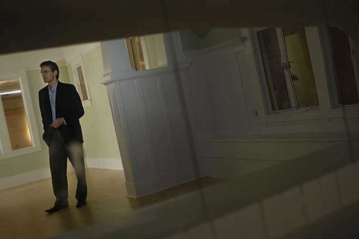 Realtor John Robin stands in a home that he helped investors buy and sell in Richmond, Calif. on Wednesday, March 24, 2010.
