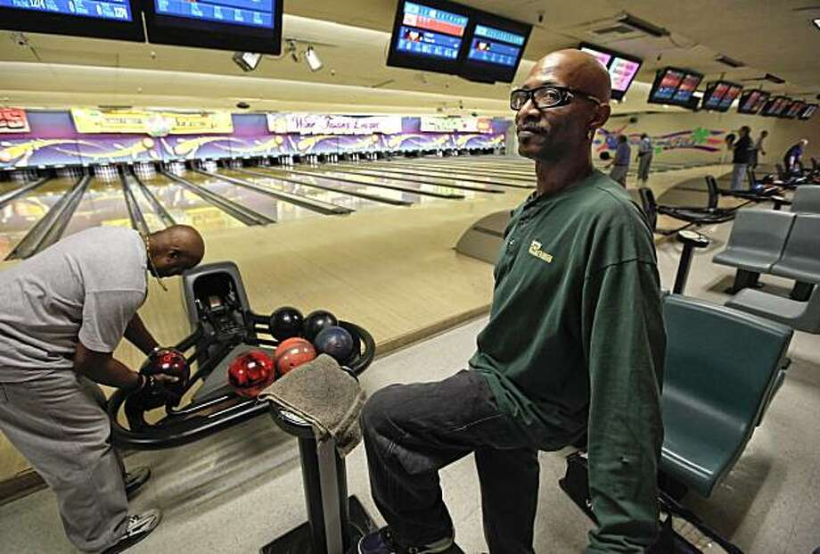 Hired in 2001 by NUMMI Bryant Hicks, (right) with his brother Johnnie, bowl at Cloverleaf Family Bowl in Fremont, Calif. on Friday Mar. 26, 2010. The New United Motor Manufacturing Incorporated plant, is to cease operations and shut down on April 1. Photo: Michael Macor, The Chronicle