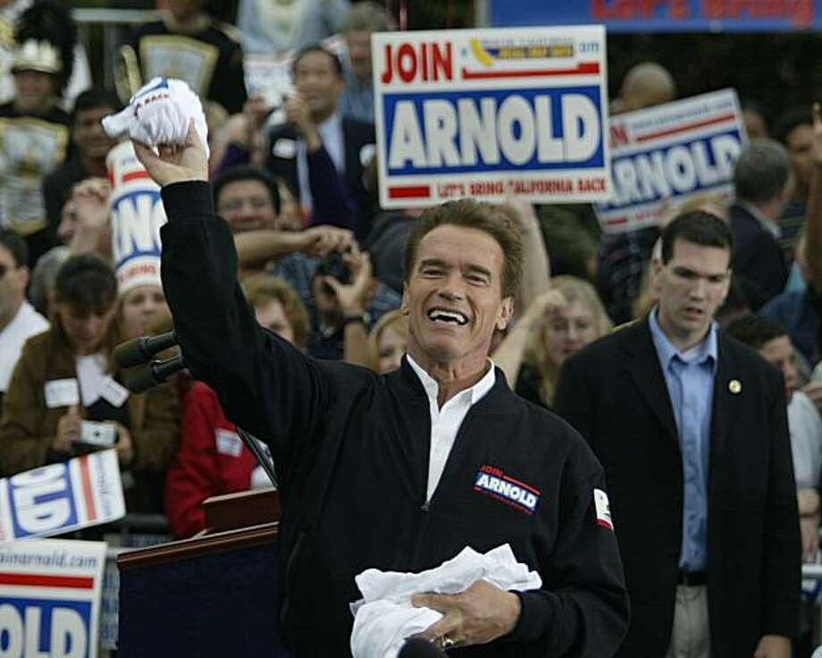 Arnold Schwarzenegger tosses t-shirts to the crowd after his speech at a rally at the Arboretum of Los Angeles County in Arcadia. The Schwarzenegger for Governor Campaign kicks off the California Comeback Express, a four-day statewide bus tour starting at the San Diego Convention Center and ending on the steps of the capitol in Sacramento. Event on 10/3/03 in Arcadia. MICHAEL MALONEY / The Chronicle Photo: Michael Maloney, The Chronicle