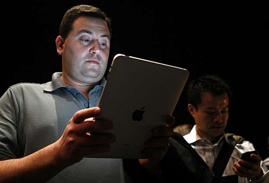 Mark Rein, vice president Epic Games, tries out the new iPad after Apple CEO Steve Jobs unveiled the tablet-style gadget at the Yerba Buena Center for the Arts in San Francisco, Calif., on Wednesday, Jan. 27, 2010. Photo: Paul Chinn, The Chronicle