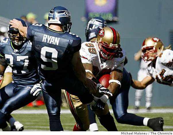 San Francisco 49ers Manny Lawson (99) blocks a kick by Seahawks Jon Ryan in the 1st half.The Seattle Seahawks host the San Francisco 49ers in a NFL game at Qwest Field in Seattle, Wash., on Sept. 14, 2008. Photo: Michael Maloney, The Chronicle