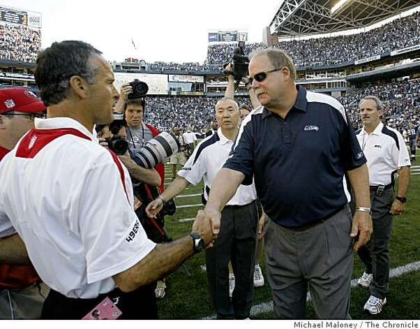 49ers head coach Mike Nolan, left, and Seahawks head coach Mike Holmgren meet after the game.The Seattle Seahawks host the San Francisco 49ers in a NFL game at Qwest Field in Seattle, Wash., on Sept. 14, 2008. The 49ers won 33-30 in overtime. Photo: Michael Maloney, The Chronicle