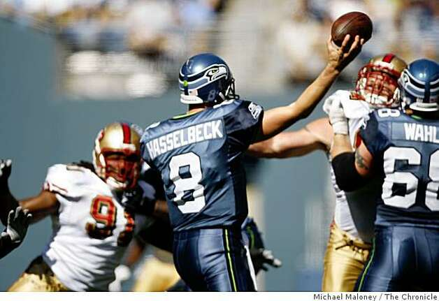 Seattle Seahawks Matt Hasselbeck (8) throws under pressure in the 3rd quarter.The Seattle Seahawks host the San Francisco 49ers in a NFL game at Qwest Field in Seattle, Wash., on Sept. 14, 2008. The 49ers won 33-30 in overtime. Photo: Michael Maloney, The Chronicle