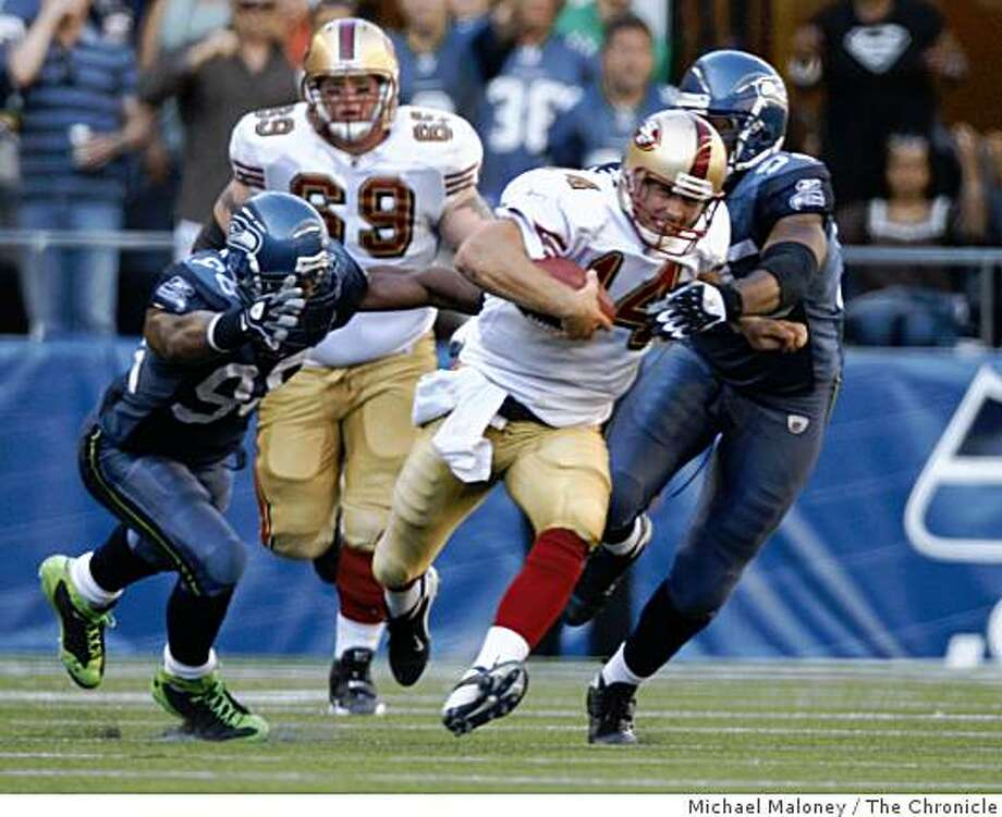 San Francisco 49ers quarterback J.T. O'Sullivan (14) is tackled by Seattle Seahawks Julian Peterson (98) and Lawrence Jackson (95) in the 4th quarter.The Seattle Seahawks host the San Francisco 49ers in a NFL game at Qwest Field in Seattle, Wash., on Sept. 14, 2008. The 49ers won 33-30 in overtime. Photo: Michael Maloney, The Chronicle