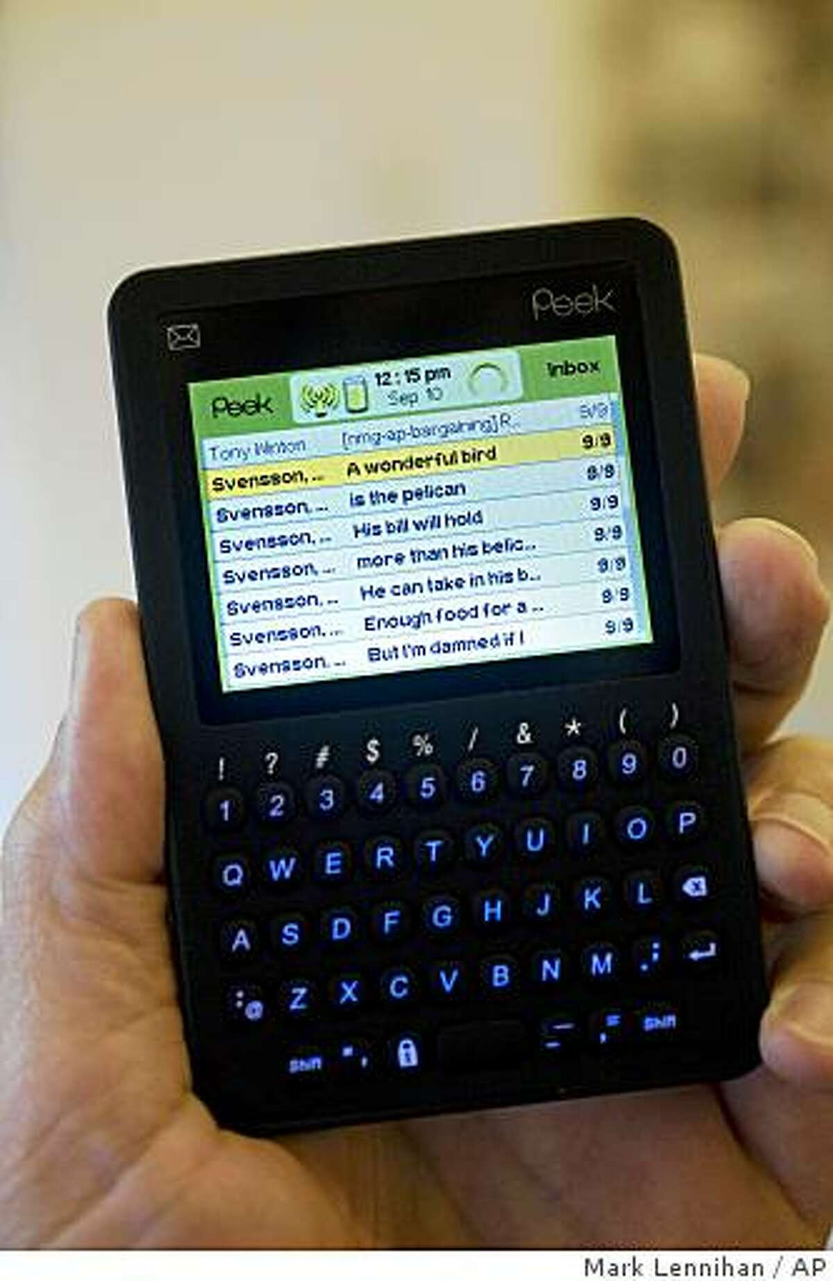 The Peek is displayed Wednesday, Sept. 10, 2008, in New York. A New York-based startup is trying to fill the niche the BlackBerry abandoned with a sleek, cheap e-mail pager that hits Target stores next Monday, Sept. 15, 2008. (AP Photo/Mark Lennihan)