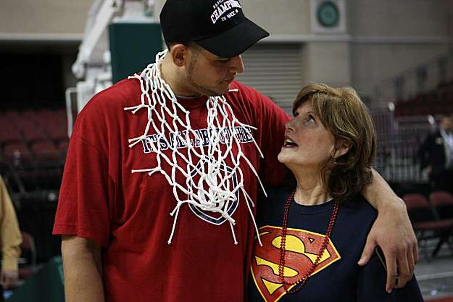 Omar Samhan with his mother, Marianne Black-Samhan, after the WCC tournament Photo: St.Mary's Athletics/Tod Fierner