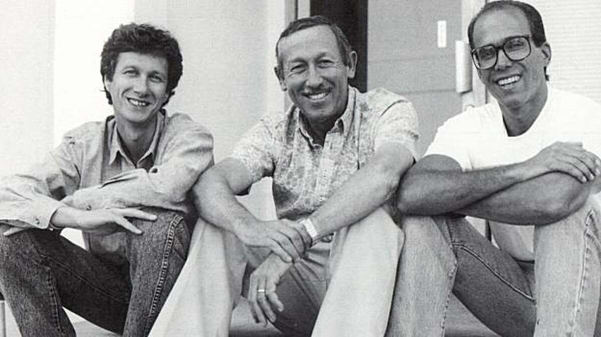 In this publicity image released by Disney, from left, Peter Schneider, Roy Disney and Jeffrey Katzenberg take a break from a story retreat in in a photo from the documentary,