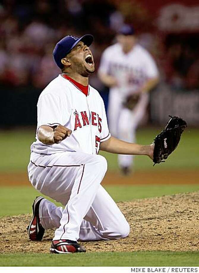 Los Angeles Angels relief pitcher Francisco Rodriguez celebrates after setting a new Major League baseball save record with his 58th save of the season following a victory over the Seattle Mariners in Anaheim ,California, September 13, 2008. Rodriguez surpassed  Bobby Thigpen's 1990 major league record of 57 with the save. Photo: MIKE BLAKE, REUTERS