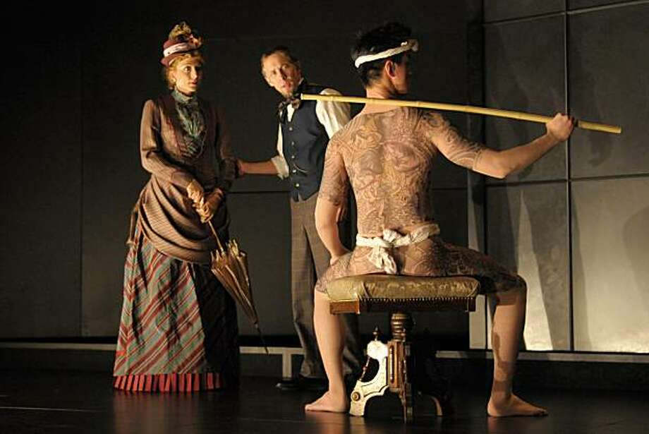 "Johnny Wu (right) models the full-body tattoos created for Berkeley Rep's world premiere of Naomi Iizuka's ""Concerning Strange Devices from the Distant West"" as Kate Eastwood Norris and Bruce McKenzie look on. Photo: Kevinberne.com"