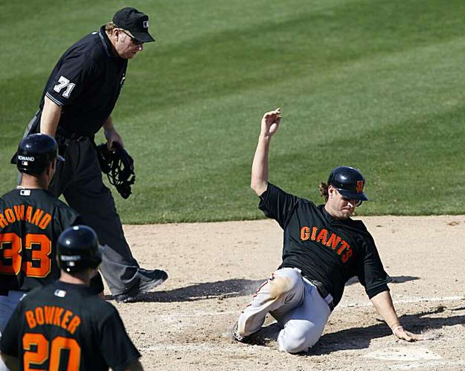 San Francisco Giants' Kevin Frandsen scores a run during the fourth inning of a spring training baseball game against the Seattle Mariners, Wednesday, March 3, 2010, in Peoria, Ariz. Photo: Charlie Neibergall, AP