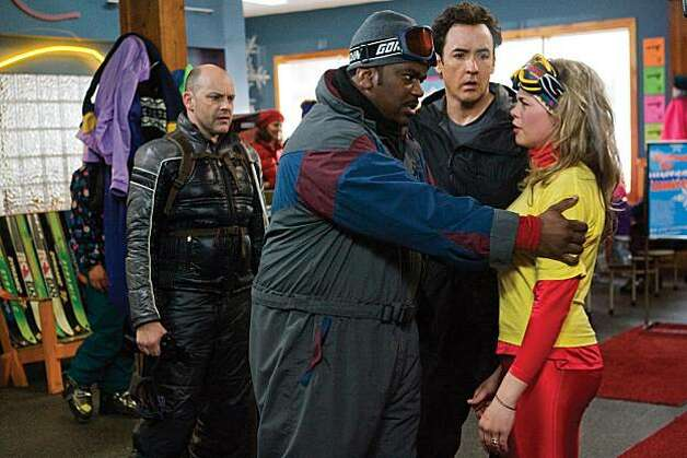 "(L to R) ROB CORDDRY as Lou, CRAIG ROBINSON as Nick, JOHN CUSACK as Adam and MEGAN HOLMES as ""Where's The Beef"" Girl in Metro-Goldwyn-Mayer Pictures and United Artists' HOT TUB TIME MACHINE. Photo: Rob McEwan, MGM"