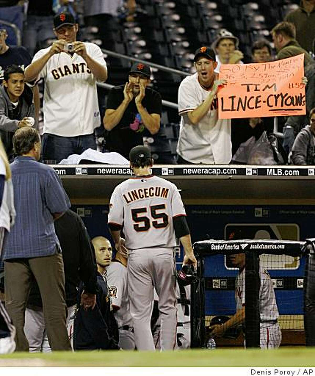 Giants fans cheer for San Francisco Giants pitcher Tim Lincecum as he leaves the field after the final out of a baseball game against the San Diego Padres on Saturday, Sept. 13, 2008 in San Diego. Lincecum pitched a complete game shut-out in the Giants 7-0 win. (AP Photo/Denis Poroy)