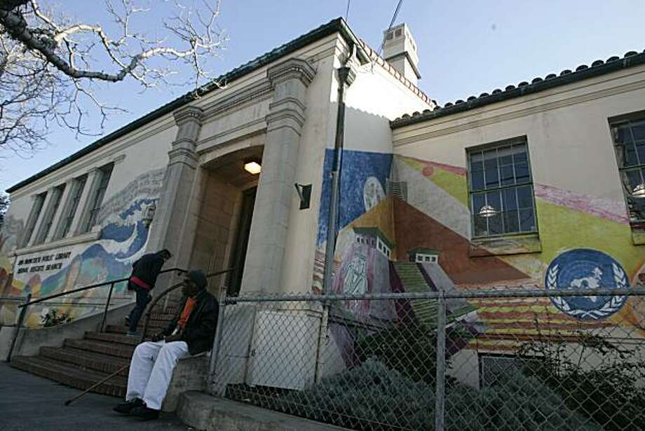 On 2/3/05 in San Francisco(L to R) regular patron Jane Krivich walks up the steps while  Walker Dunning sits outside of the mural covered 1940's-era Bernal Library in Bernal Heights neighborhoon on Courtland Avenue. Photo: Kat Wade, The Chronicle