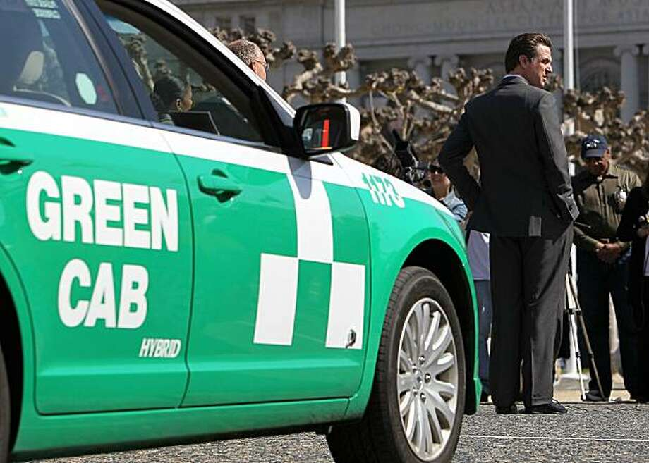 SAN FRANCISCO - MARCH 22:  San Francisco mayor Gavin Newsom stands next to a hybrid taxicab during a news conference March 22, 2010 in San Francisco, California. San Francisco mayor Gavin Newsom announced today that 55 percent of the city's taxi fleet arealternative fuel vehicles, including hybrids and compressed natural gas vehicles. Newsom sponsored a Green Taxi Law that required San Francisco cab companies to lower their greenhouse gas emissions 20 percent below 1990 levels by 2012. Photo: Justin Sullivan, Getty Images