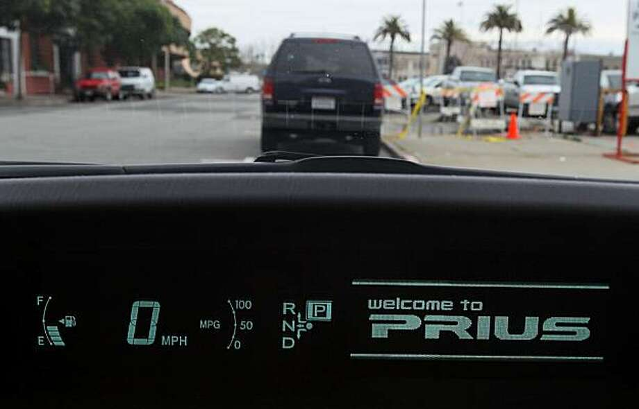 SAN FRANCISCO - FEBRUARY 04:  A welcome message is displayed on the dashboard of a 2010 Toyota Prius hybrid car February 4, 2010 in San Francisco, California. The  National Highway Traffic Safety Administration (NHTSA) has reportedly said it would look into reports from consumers about brake problems on 2010 Prius,. Photo: Justin Sullivan, Getty Images