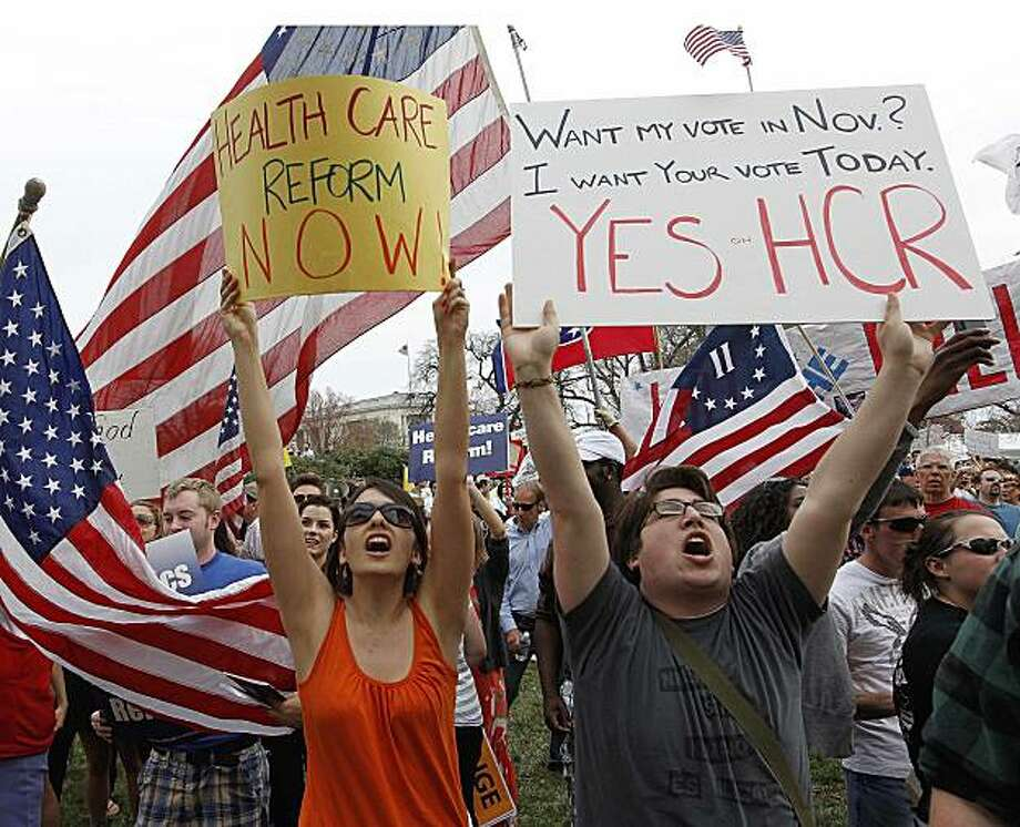 Demonstrators in favor of the health care reform bill chant outside of the U.S. Capitol as the House prepares to vote on the bill in Washington, Sunday, March 21, 2010. Photo: Charles Dharapak, AP