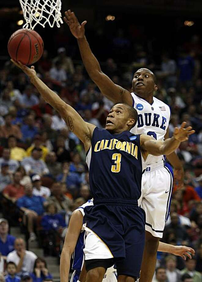 California's Jerome Randle (3) attempts a basket as Duke's  Nolan Smith defends during the first half of an NCAA second-round college basketball game in Jacksonville, Fla., Sunday, March 21, 2010. Photo: Steve Helber, AP