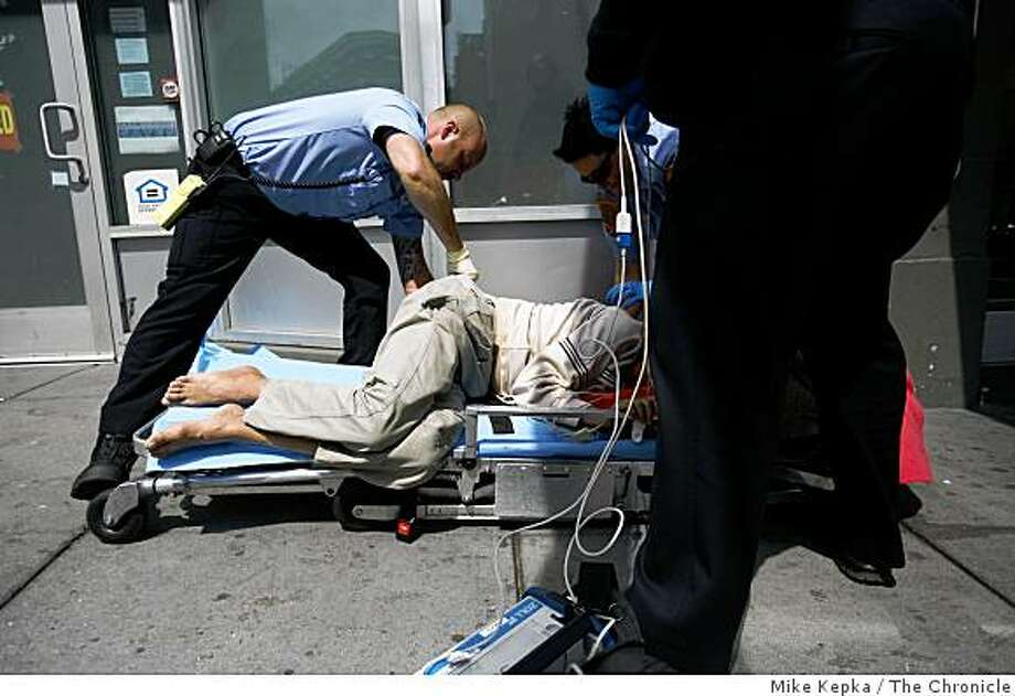 A team of dynamically deployed paramedics with the San Francisco Fire Department respond to collapsed patient in the Tenderloin district of San Francisco on Friday May 18, 2007 in San Francisco Calif. Photo: Mike Kepka, The Chronicle