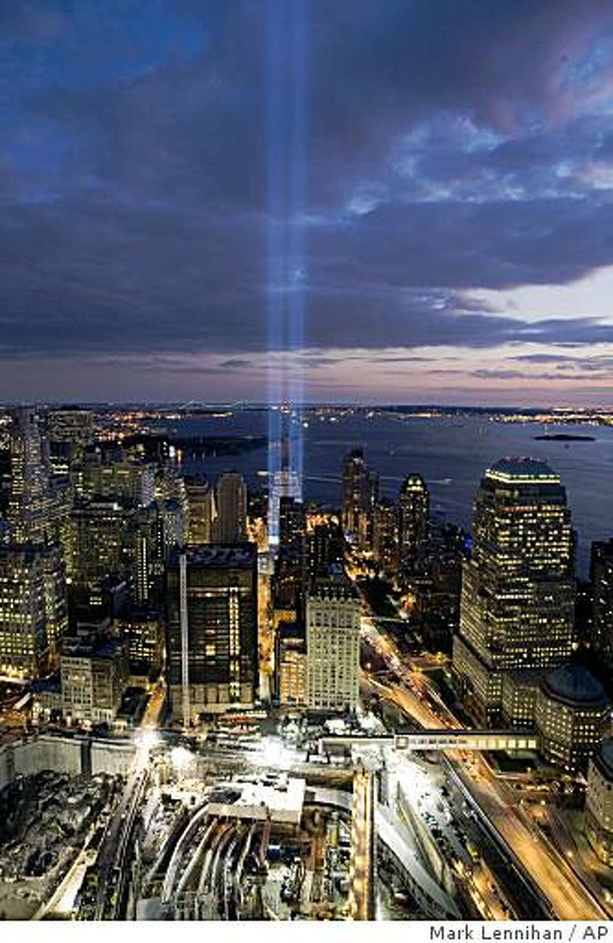 """A short test of the """"Tribute in Light"""" illuminates the sky over the World Trade Center site Wednesday, Sept. 10, 2008 in New York. The Tribute in Light will be turned on for the evening of Thursday, Sept. 11, in honor of those who lost their lives seven years ago in the terrorist attacks on the United States. (AP Photo/Mark Lennihan)"""