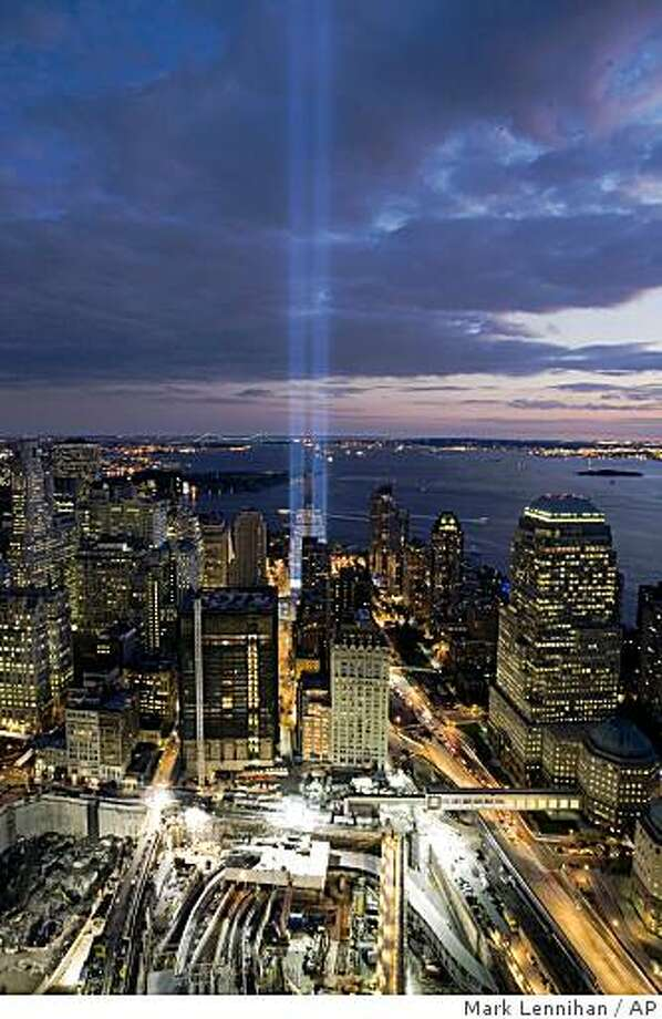 "A short test of the ""Tribute in Light"" illuminates the sky over the World Trade Center site Wednesday, Sept. 10, 2008 in New York. The Tribute in Light will be turned on for the evening of Thursday, Sept. 11, in honor of those who lost their lives seven years ago in the terrorist attacks on the United States. (AP Photo/Mark Lennihan) Photo: Mark Lennihan, AP"