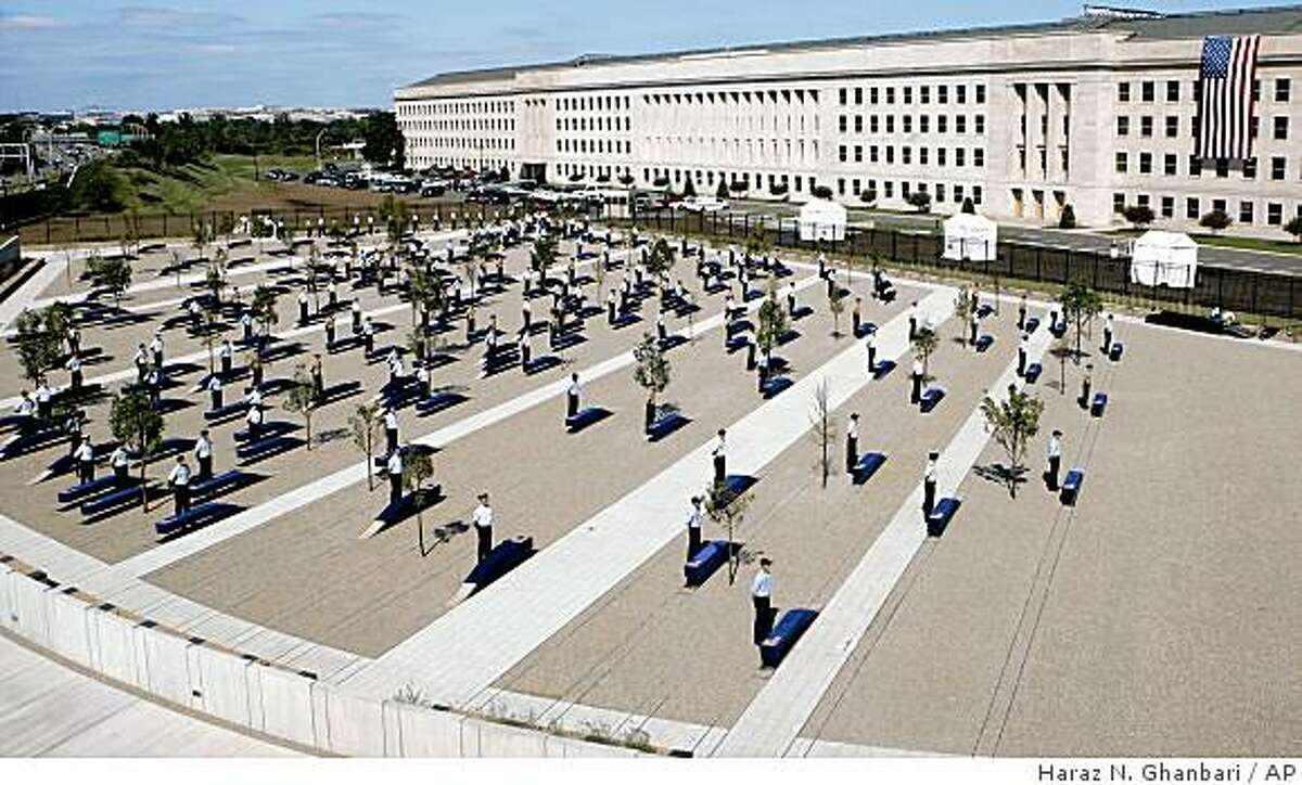 Members of the military do a walk-through at the Pentagon, Wednesday, Sept. 10, 2008, for Thursday's opening of The Pentagon Memorial, dedicated in honor of the victims of the Sept. 11, 2001 attack on the Pentagon. (AP Photo/Haraz N. Ghanbari)