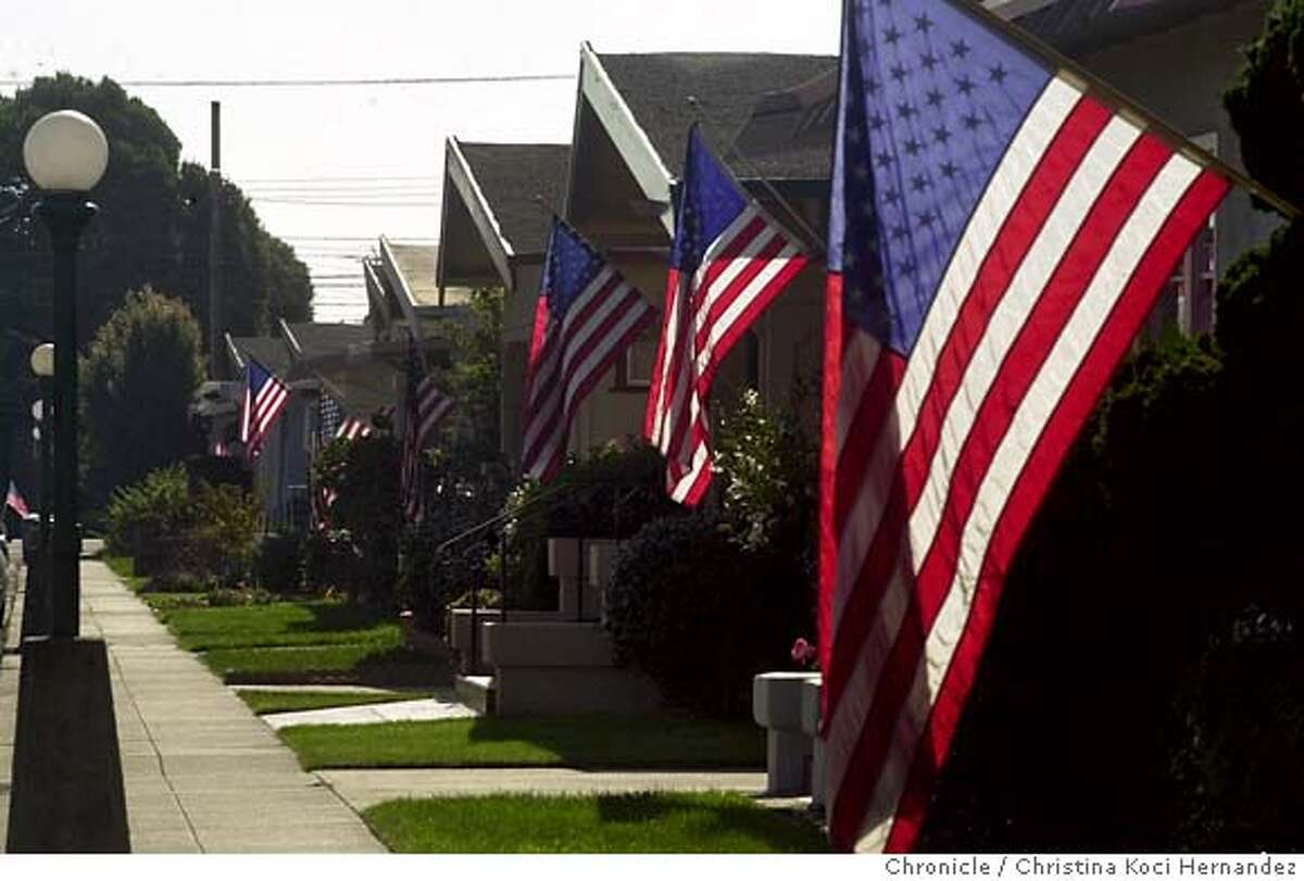 PATRIOTISMe-C-18OCT01-MT-CKH CHRISTINA KOCI HERNANDEZ/CHRONICLE On Sterling Ave in Alameda, near High St., almost every home flew the American flag. Signs of patriotism in the East Bay. CAT