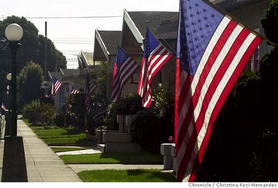 PATRIOTISMe-C-18OCT01-MT-CKH CHRISTINA KOCI HERNANDEZ/CHRONICLE On Sterling Ave in Alameda, near High St., almost every home flew the American flag. Signs of patriotism in the East Bay. CAT Photo: CHRISTINA KOCI HERNANDEZ