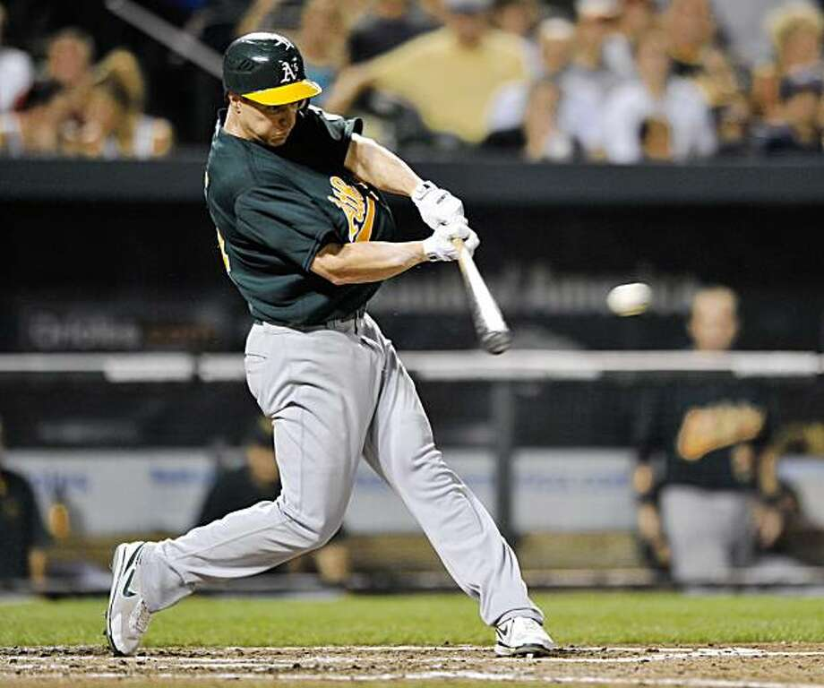 Oakland Athletics Mark Ellis connects for a two run single against the Baltimore Orioles in the fifth inning of a baseball game Monday, Aug. 10, 2009 in Baltimore. Photo: Gail Burton, AP