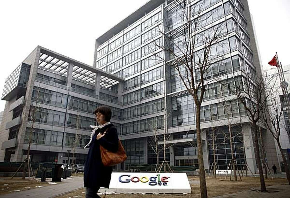 A woman walks past Google China headquarters in Beijing, Thursday, March 18, 2010. Chinese companies that sell advertising on Google's China search engine have appealed for information on its future and say they might want compensation if it is shut down.