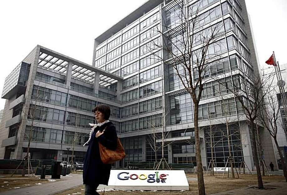 A woman walks past Google China headquarters in Beijing, Thursday, March 18, 2010. Chinese companies that sell advertising on Google's China search engine have appealed for information on its future and say they might want compensation if it is shut down. Photo: Andy Wong, AP