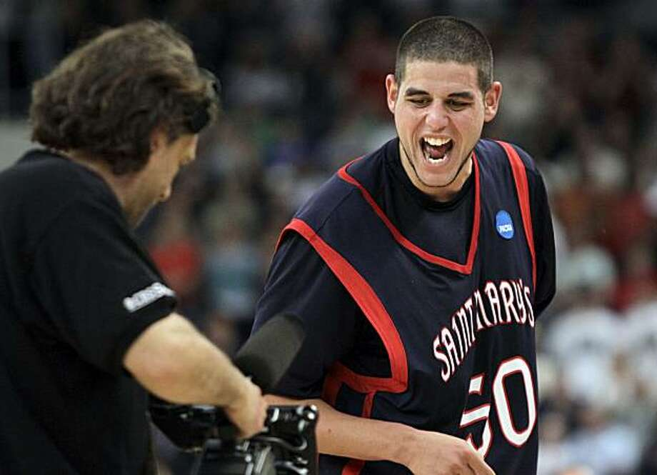 Saint Mary's Omar Samhan celebrates for a television cameraman after his team's 75-68 win over Villanova in an NCAA second-round college basketball game in Providence, R.I., Saturday, March 20, 2010. Photo: Elise Amendola, AP