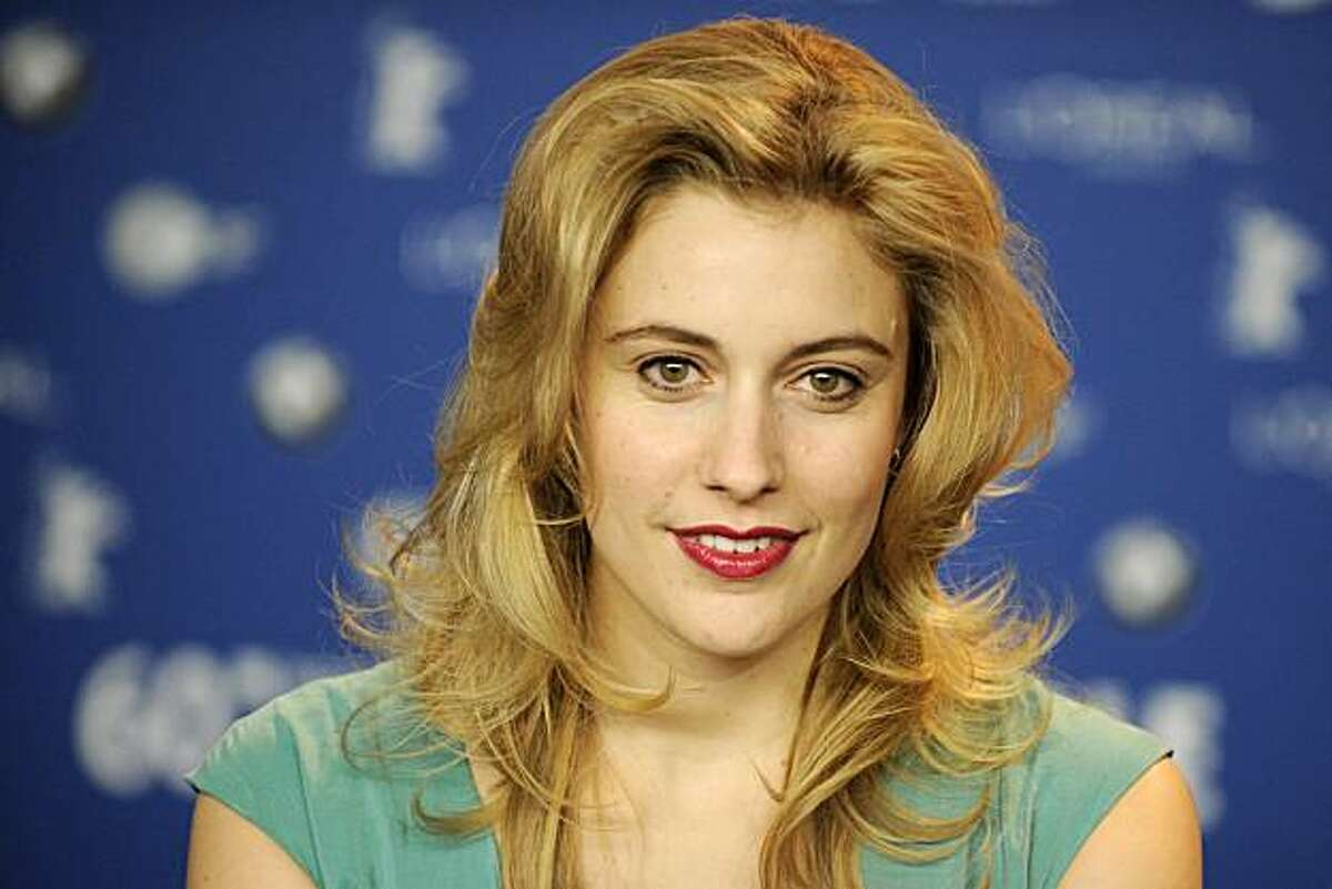 """US actress Greta Gerwig poses during the press conference for the film """"Greenberg"""" competing in the 60th Berlinale Film Festival in Berlin February 14, 2010. Twenty pictures are vying for the coveted Golden Bear top prize at the Berlinale film festival taking place from February 11 to 21, 2010. AFP PHOTO DDP/ AXEL SCHMIDT GERMANY OUT (Photo credit should read AXEL SCHMIDT/AFP/Getty Images)"""