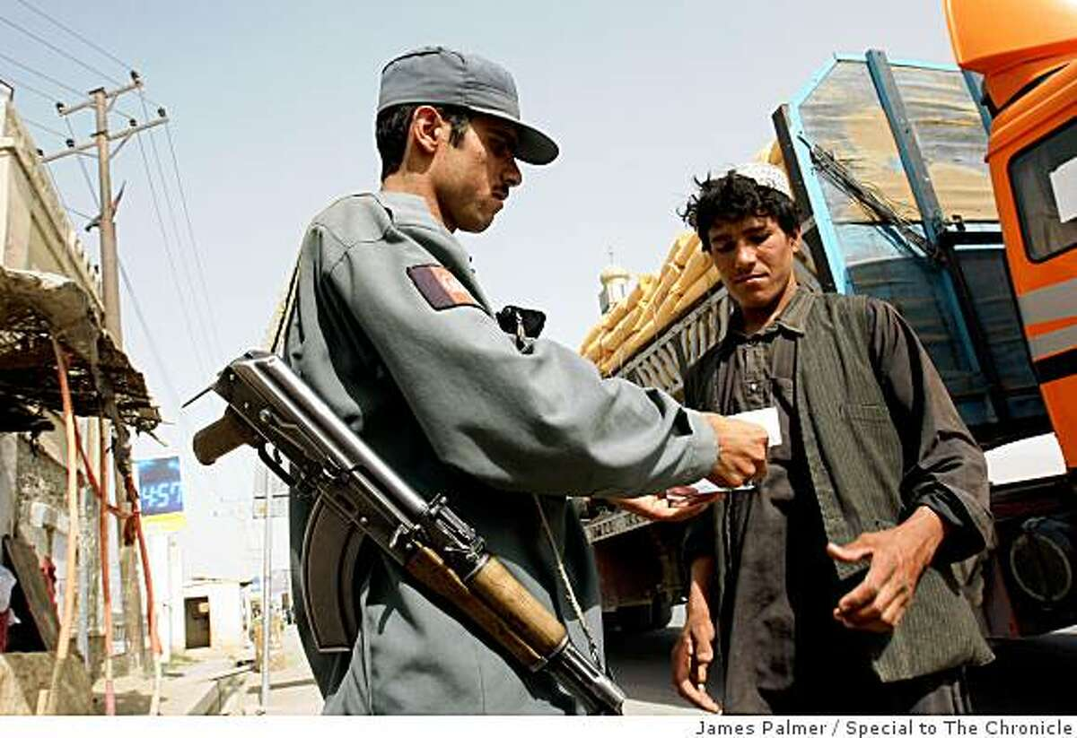 Graan Mohammed, an Afghan policeman, posted at checkpoint in the streets of the restive city of Kandahar, Afghanistan, on July 14, 2008. Mohammed is one of the many inexperienced and poorly equipped officers in the Kandahar province who are facing an increasingly powerful Taliban-led insurgency.