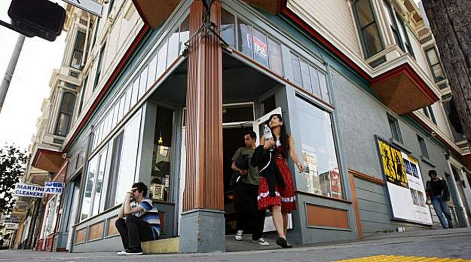 A former corner liquor store has reopened as a new coffee house on Divisadero Street. Photo: Lance Iversen, The Chronicle