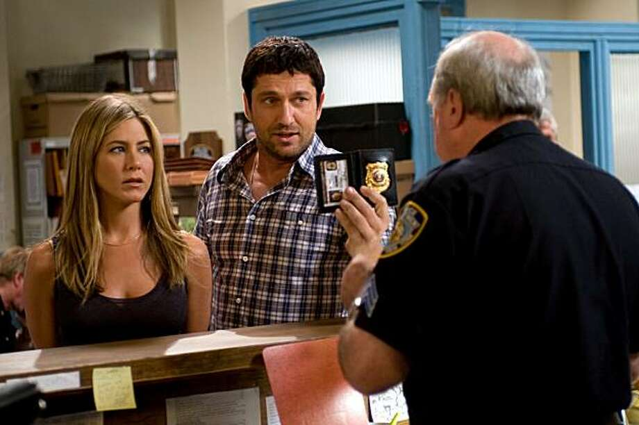 Gerard Butler and Jennifer Aniston star in Columbia Pictures' action comedy THE BOUNTY HUNTER. Photo: Barry Wetcher SMPSP, Columbia TriStar