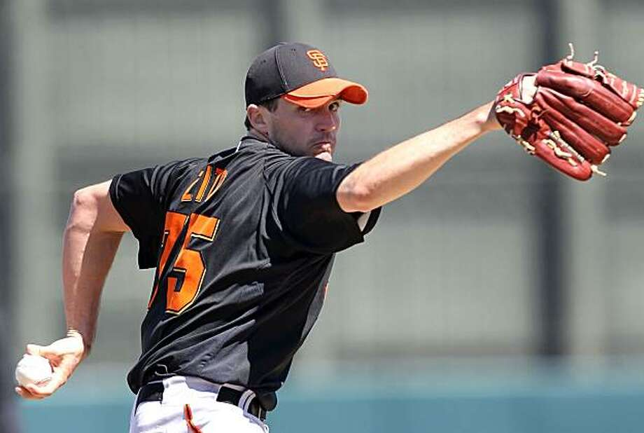 PHOENIX - MARCH 17:  Starting pitcher Barry Zito #75 of the San Francisco Giants pitches against the Oakland Athletics during the MLB spring training game at Phoenix Municipal Stadium on March 17, 2010 in Phoenix, Arizona. The Giants defeated the A's 6-1. Photo: Christian Petersen, Getty Images
