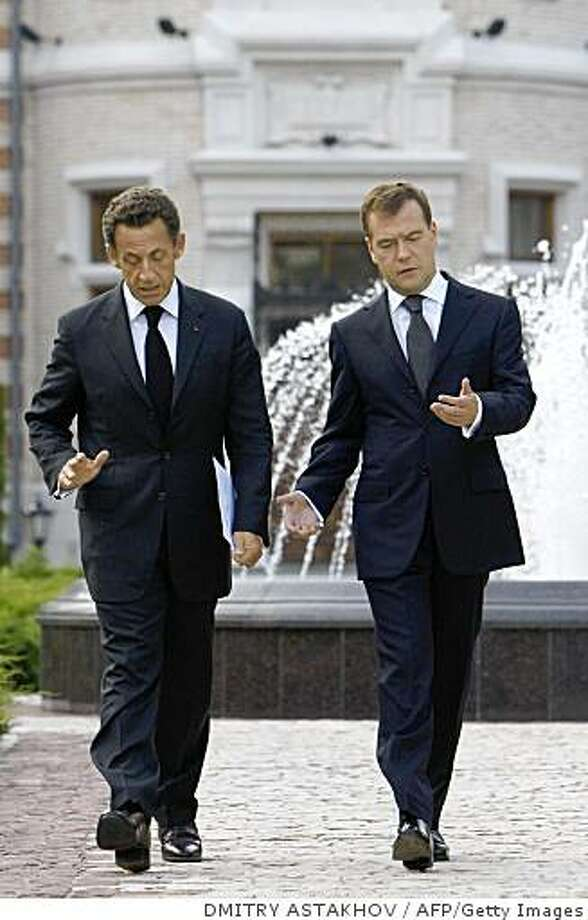 Russian President Dmitry Medvedev (R) and his French counterpart Nicolas Sarkozy (L) walk before a news conference in Meindorf residence outside Moscow on September 8, 2008. Sarkozy sought Monday to ramp up pressure on Russia to withdraw troops from Georgia in a trip to Moscow exactly a month after the neighbours went to war. AFP PHOTO / RIA NOVOSTI / KREMLIN POOL / DMITRY ASTAKHOV (Photo credit should read DMITRY ASTAKHOV/AFP/Getty Images) Photo: DMITRY ASTAKHOV, AFP/Getty Images