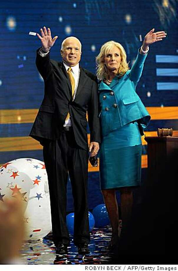 Republican presidential candidate Arizona Senator John McCain with his wife Cinday wave after delivering speech at the Republican National Convention in St Paul, Minnesota on September 4, 2008. John McCain on September 4 vowed to fight for America as long as he draws breath, in a patriotic pledge to bring political change as he accepted the Republican White House nomination. AFP PHOTO Robyn BECK (Photo credit should read ROBYN BECK/AFP/Getty Images) Photo: ROBYN BECK, AFP/Getty Images