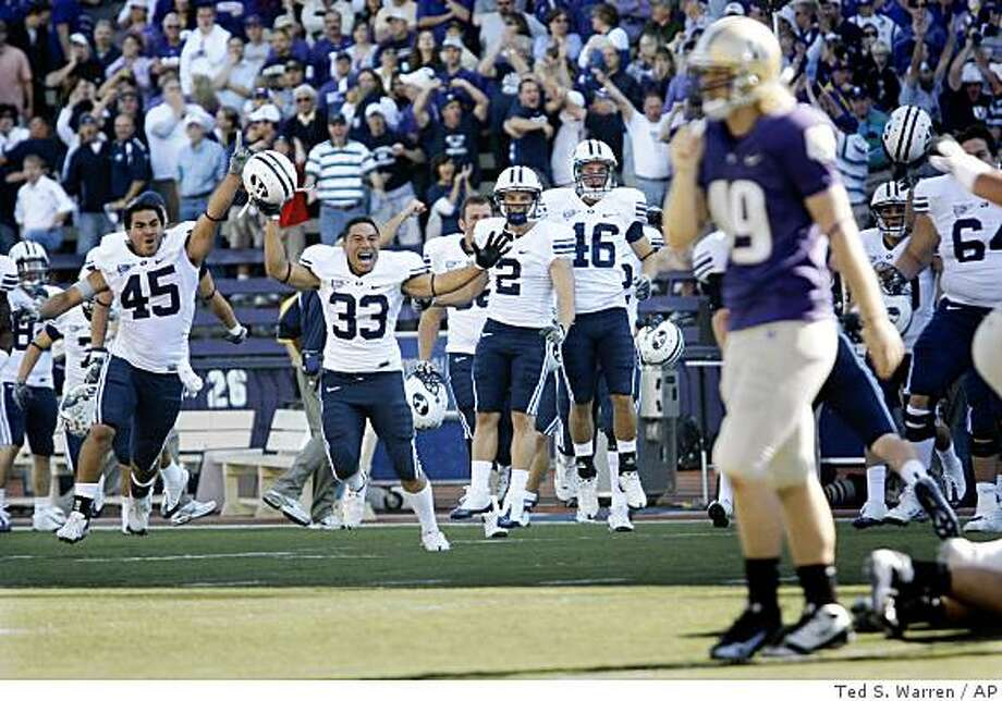 BYU players (from left) Harvey Unga, Wayne Latu, Bryce Mahuika, and Blake Morgan celebrate as Washington's Danny Morovick walks off the field after BYU blocked a Washington point-after attempt in the fourth quarter of an NCAA college football game to give BYU a 28-27 win, Saturday, Sept. 6, 2008, at Husky Stadium in Seattle.  (AP Photo/Ted S. Warren) Photo: Ted S. Warren, AP