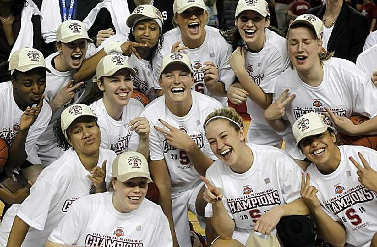 Stanford players celebrate after defeating UCLA 70-46 in an NCAA college basketball game in the finals of the women's Pac-10 tournament Sunday, March 14, 2010, in Los Angeles.
