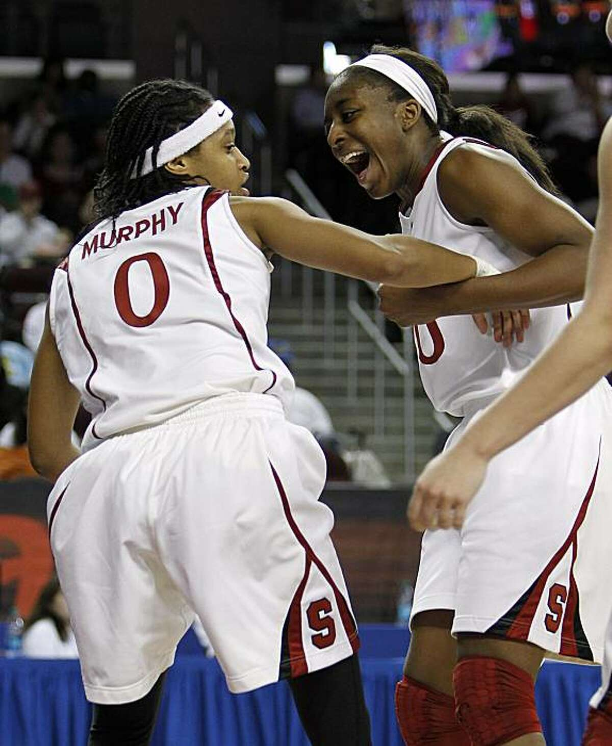 Stanford forward Nnemkadi Ogwumike, right, congratulates guard Melanie Murphy (0) on a play in the second half against UCLA in an NCAA college basketball game in the finals of the women's Pac-10 tournament Sunday, March 14, 2010, in Los Angeles. Stanfordwon 70-46.