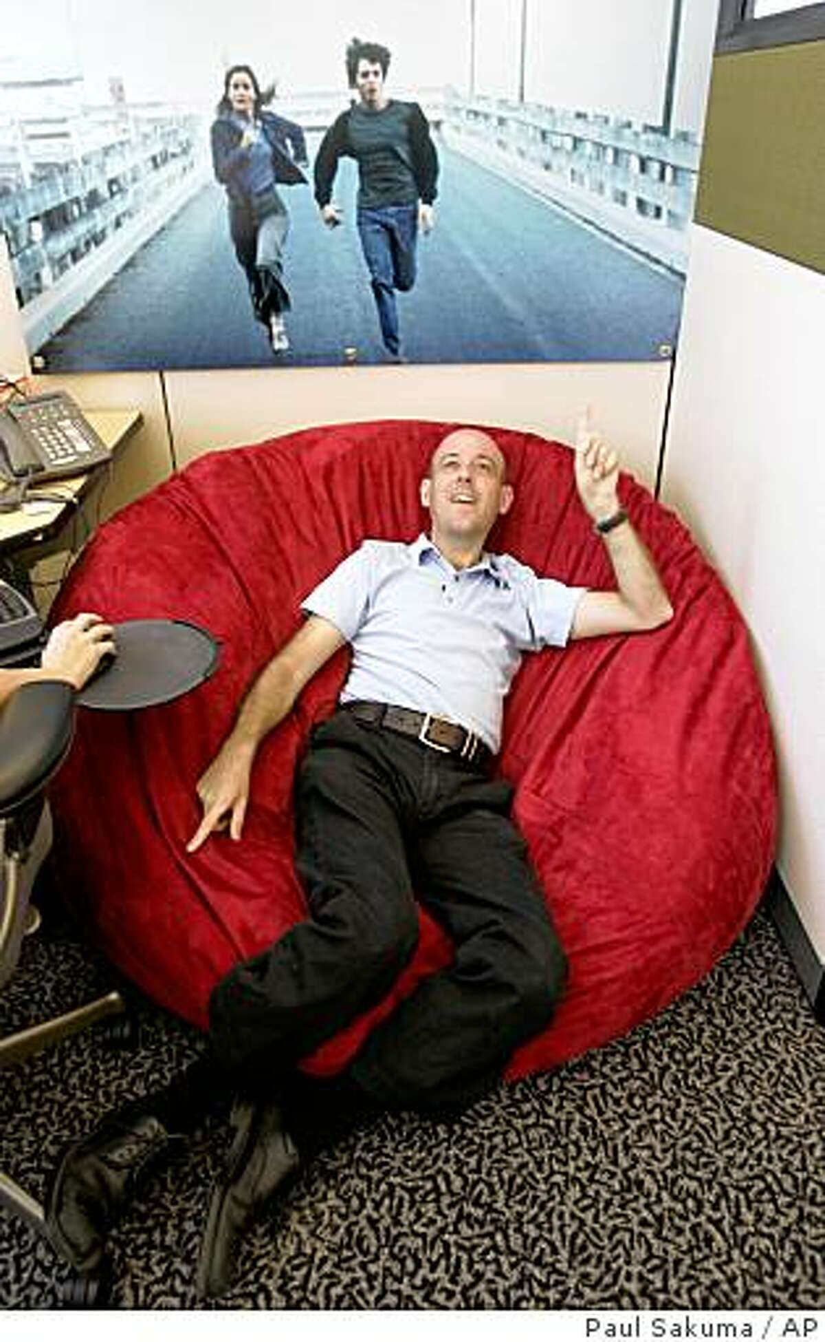** FOR RELEASE WEEKEND SEPTEMBER 6-7 ** Google Technology Director Craig Silverstein, who was Google's first employee, sits on his beanbag chair in his office at Google headquarters in Mountain View, Calif., Wednesday, Aug. 27, 2008. When Larry Page and Sergey Brin founded Google Inc. on Sept. 7, 1998, they had little more than their ingenuity, four computers and an investor's $100,000 bet on their belief that an Internet search engine could change the world. (AP Photo/Paul Sakuma)