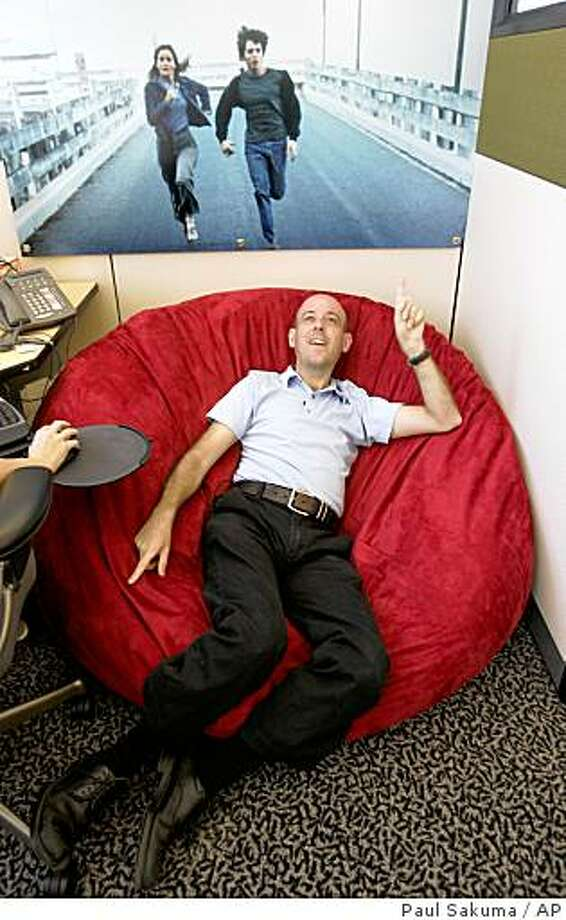 ** FOR RELEASE WEEKEND SEPTEMBER 6-7 ** Google Technology Director Craig Silverstein, who was Google's first employee, sits on his beanbag chair in his office at Google headquarters in Mountain View, Calif., Wednesday, Aug. 27, 2008. When Larry Page and Sergey Brin founded Google Inc. on Sept. 7, 1998, they had little more than their ingenuity, four computers and an investor's $100,000 bet on their belief that an Internet search engine could change the world.  (AP Photo/Paul Sakuma) Photo: Paul Sakuma, AP