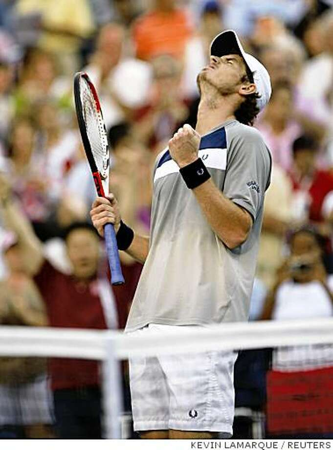 Andy Murray of Britain reacts after defeating Rafael Nadal of Spain at the conclusion of their rain delayed semi-final match at the U.S. Open tennis tournament at Flushing Meadows in New York September 7, 2008.     REUTERS/Kevin Lamarque (UNITED STATES) Photo: KEVIN LAMARQUE, REUTERS