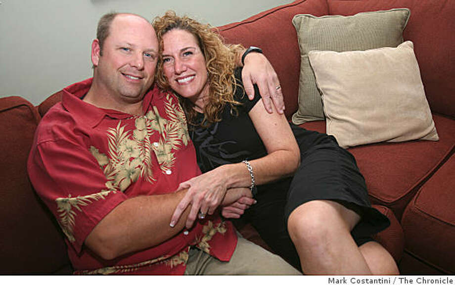Marty Gustafson, left and Lisa Manzi Gustafson pose at their home in Benicia, Calif., on Wednesday, September 3, 2008. Photo: Mark Costantini, The Chronicle