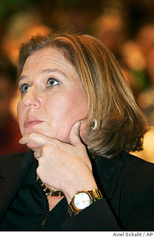 ** FILE **  Israel's Foreign Minister Tzipi Livni looks on during an education conference in Holon, Israel, Tuesday, Aug. 26, 2008. For the first time in 40 years, a woman is within reach of becoming the prime minister of Israel, a nation dominated by macho military men and a religious establishment with strict views on the role of women. But unlike Hillary Clinton or Sarah Palin, Livni doesn't talk about cracking any glass ceilings. (AP Photo/Ariel Schalit) Photo: Ariel Schalit, AP