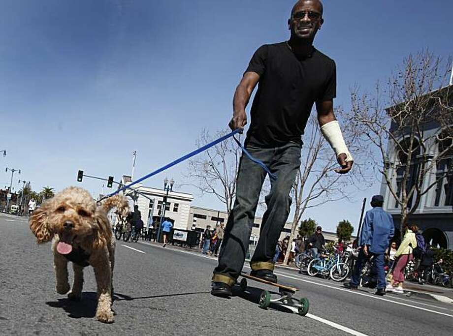 Greg Smith and his dog Ngozi came all the way from Morgan Hill for San Francisco's first Sunday Streets event of the year, which shut down the Embarcadero from the AT&T Park to Pier 45. Photo: Brant Ward, The Chronicle