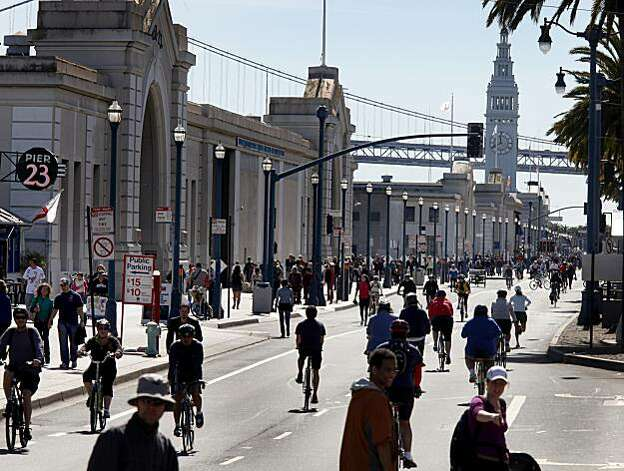 Bicyclists take over the eastern side of the Embarcadero while walkers use the wide sidewalks during San Francisco's first Sunday Streets event of the year, which shut down the Embarcadero from the AT&T Park to Pier 45. Photo: Brant Ward, The Chronicle
