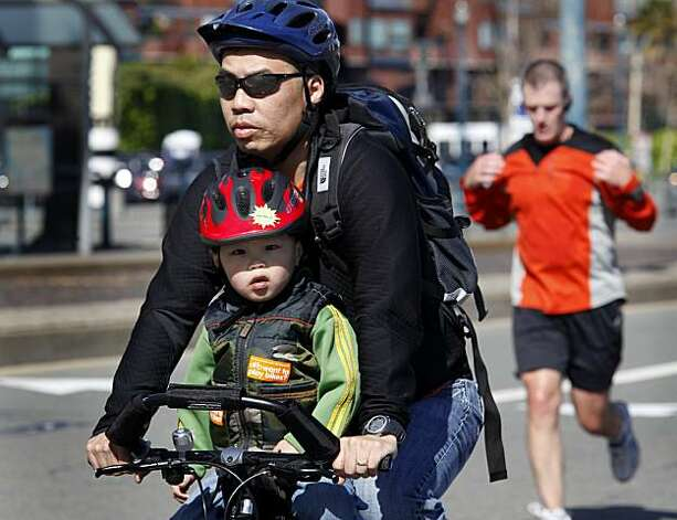Most bicycle riders wore helmets and gladly shared the roadway with runners, skaters and walkers at San Francisco's first Sunday Streets event of the year, which shut down the Embarcadero from the AT&T Park to Pier 45. Photo: Brant Ward, The Chronicle